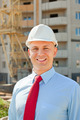 Portrait of builder at building site