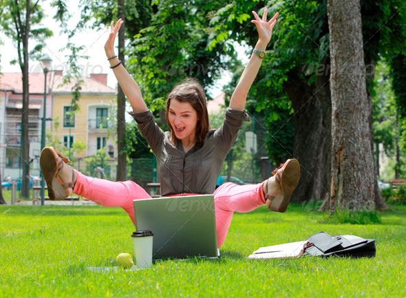 Happy Woman with Computer in an Urban Park - Stock Photo - Images