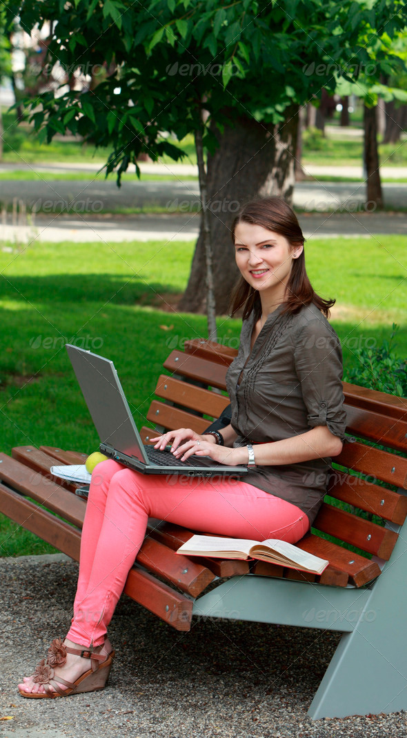 Young Woman with a Laptop in a Park  - Stock Photo - Images