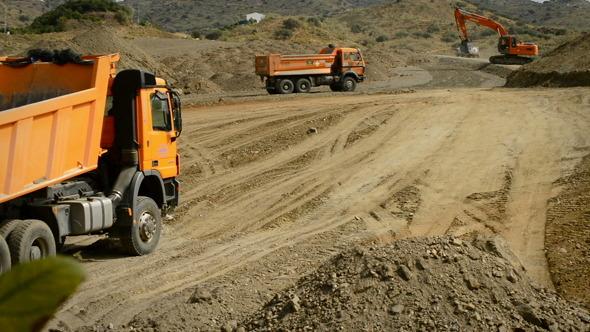 Trucks and Excavator Working