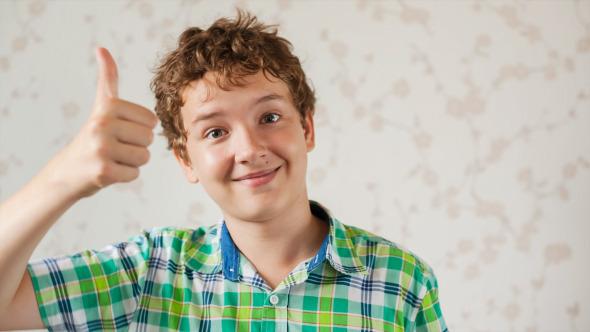Teenager Boy Communicates by Webcam