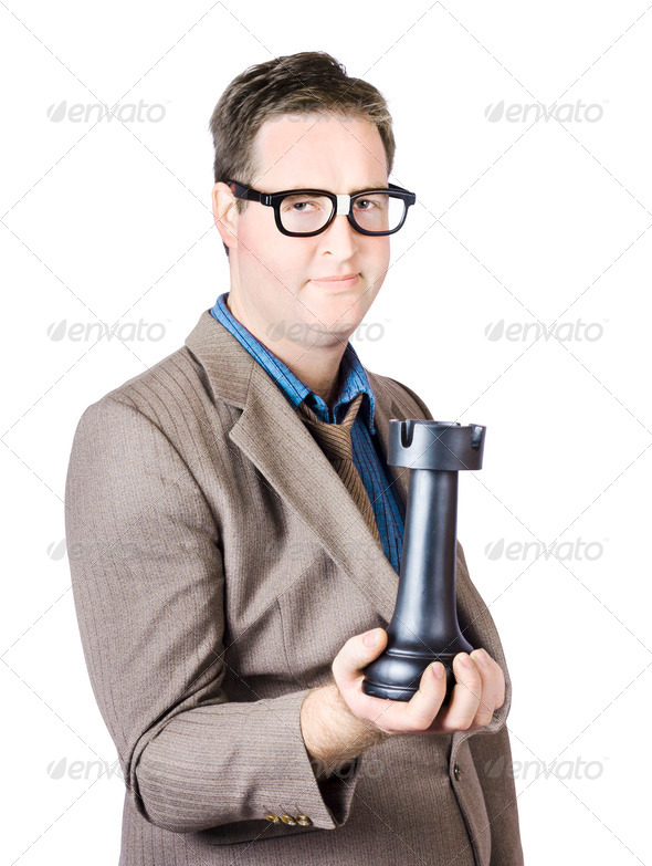Businessman moves chess castle figure - Stock Photo - Images