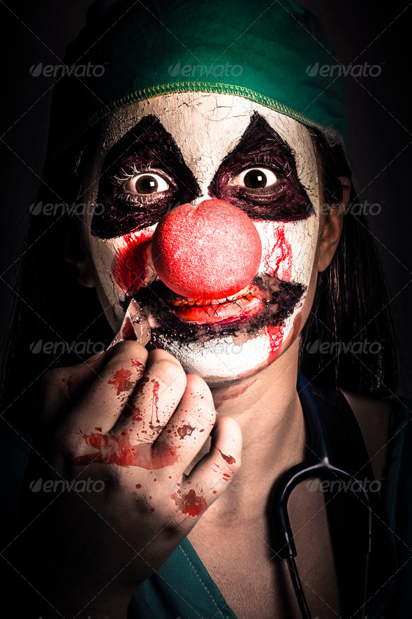 Horror clown girl in silence with stitched lips - Stock Photo - Images