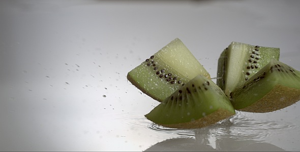 VideoHive Halve Kiwi is Falling and Dividing on Wet Surface 9845078