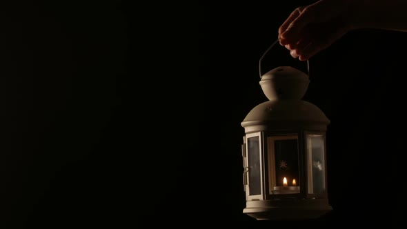 VideoHive Hand Holding Lantern With Candle Light 18701026