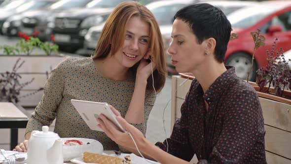 VideoHive Women Watching Video on Tablet 19667559