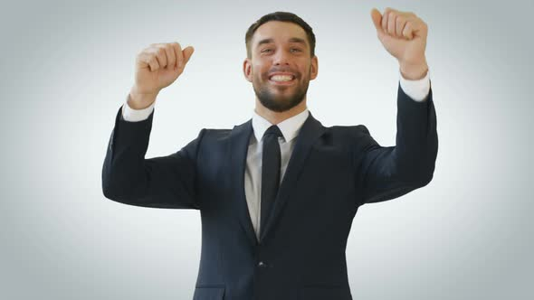VideoHive Smiling Businessman Dancing with His Hands Raised 19462079