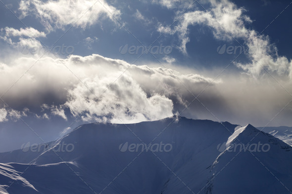 Mountains in evening and sunlit clouds - Stock Photo - Images