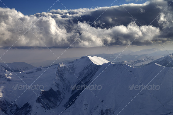 Winter mountains in evening and cloudy sky - Stock Photo - Images