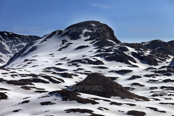 Rocks in snow - Stock Photo - Images