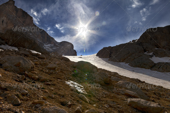 Mountain pass and blue sky with sun - Stock Photo - Images