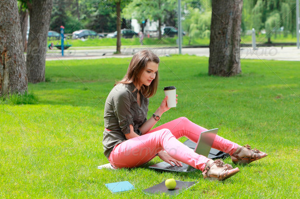 Young Woman With Laptop in an Urban Park  - Stock Photo - Images
