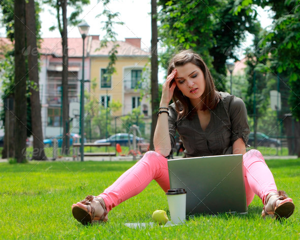 Young Woman with Laptop Outside - Stock Photo - Images