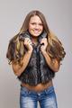 Attractive teenage girl wearing short fur coat smiling - PhotoDune Item for Sale