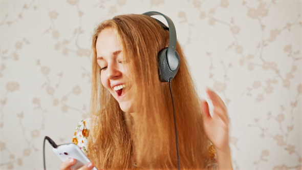 The Young Girl Listens to Music