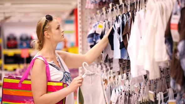 Mother Shopping For Childrens Clothes