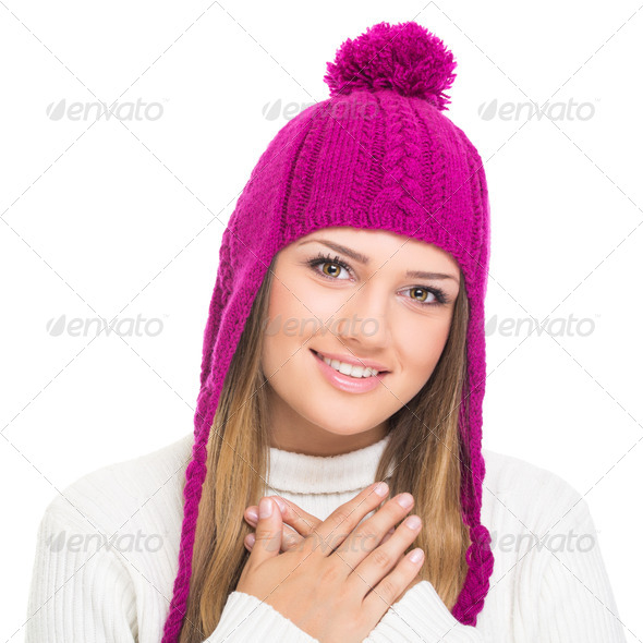 Cute teenage girl wearing pink knitted hat - Stock Photo - Images