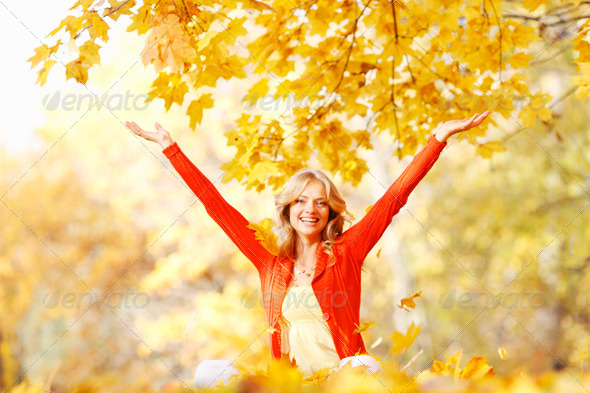 Happy woman in autumn park - Stock Photo - Images