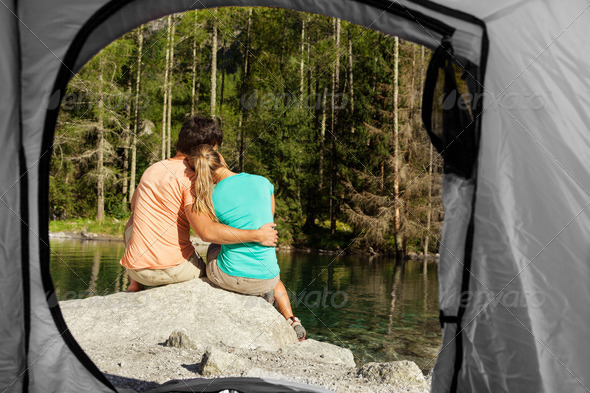 view of a couple that camps from the inside of a tent - Stock Photo - Images