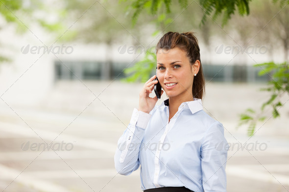 Brunette businesswoman is phoning - Stock Photo - Images
