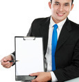 young business man showing blank clipboard