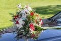 Wedding car with a bouquet of flowers