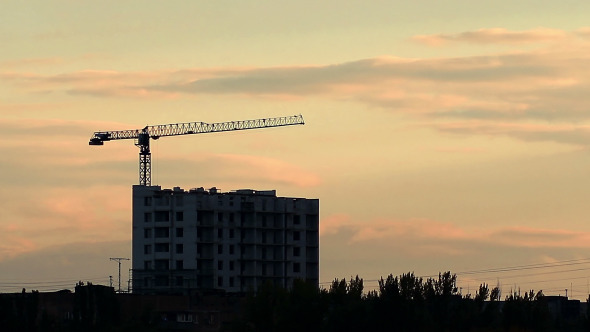 Silhouette Of Crane Working At Sunset