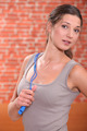 Woman with skipping rope in the gym