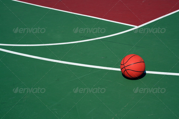 Basketball at three point line