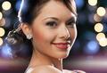 woman in evening dress wearing diamond earrings