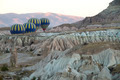 Hot Air Balloons Flying Between the Rocks  Over Cappadocia Turkey - PhotoDune Item for Sale