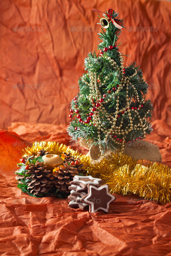 Christmas tree, garlands, decorations and candles, gingerbread cookies - Stock Photo - Images