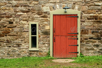 Red door on a old stone building