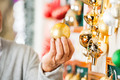 Man Holding Golden Christmas Bauble At Store - PhotoDune Item for Sale