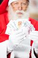 Santa Claus Holding Money - PhotoDune Item for Sale