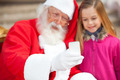Santa Claus And Girl Taking Selfportrait Through Smartphone - PhotoDune Item for Sale