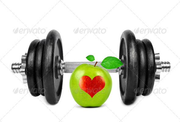 Black dumbbell with apple - Stock Photo - Images