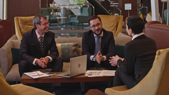 Download Business Discussion in the Hotel Lobby nulled download
