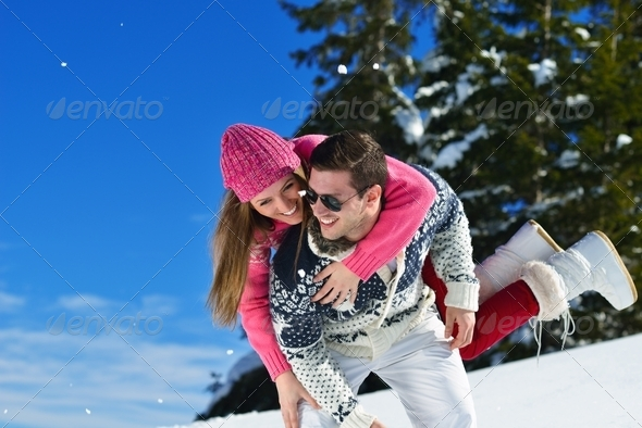 young couple on winter vacation - Stock Photo - Images