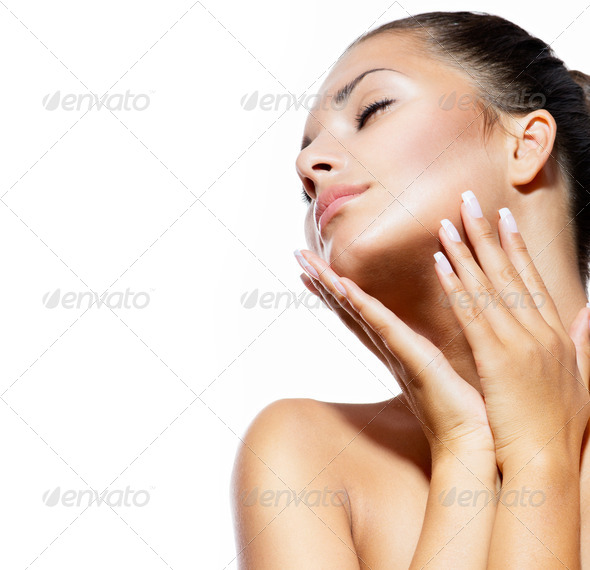 Beauty Portrait. Beautiful Spa Woman Touching her Face - Stock Photo - Images