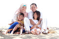 Portrait of happy muslim family in the beach