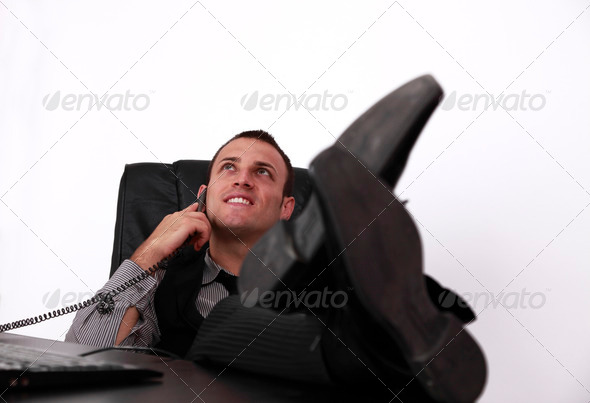Relaxed Young Businessman on the Phone - Stock Photo - Images