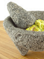 Molcajete Mortar And Pestle Bowl Filled With Guacamole - PhotoDune Item for Sale