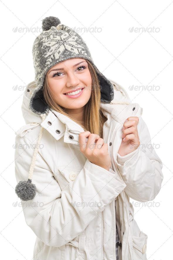Beautiful teenage girl wearing winter beanie hat and jacket posing - Stock Photo - Images