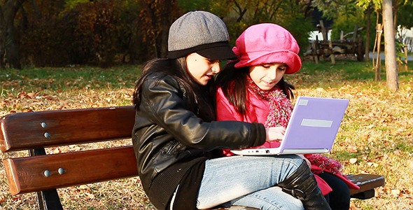 Two Girls Playing On Laptop 3