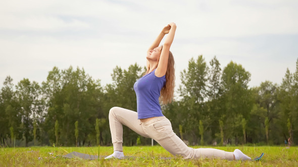 Young Woman Exercising in a Meadow