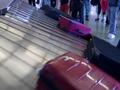 Waiting people claim baggage airport conveyor belt
