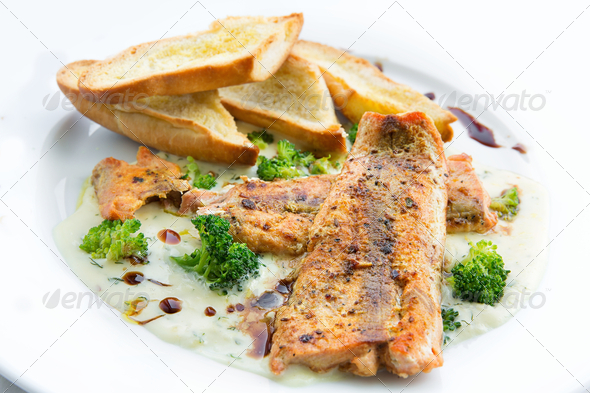 Lightly fried salmon with herb sauce - Stock Photo - Images