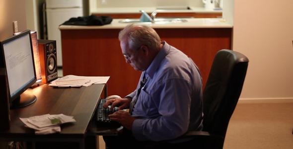 Older Man Typing