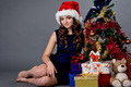 Beautiful girl sitting with a Christmas tree  - PhotoDune Item for Sale
